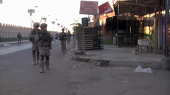 United States Army soldiers patrol streets of Baghdad in the morning 1 - stock footage