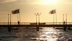 People silhouettes crossing bridge during sunset - Full HD Stock Footage