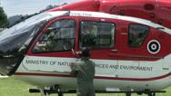 Stock Video Footage of HELICOPTER GROUND STAFF PREPARE TAKE OFF