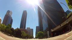 POV- Low Angle Car Driving Through Downtown Area Under Hot Sun Stock Footage