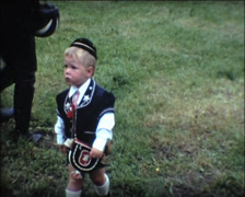 SUPER8 SWITZERLAND kid in traditional clothing - 1970 Stock Footage