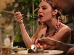 Couple eating dinner in outdoor restaurant NTSC Stock Footage