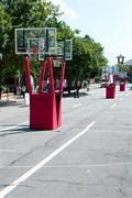 Basketball goals set up on city street for outdoor tournament Stock Photos