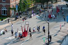 men play in basketball tournament on city street - stock photo