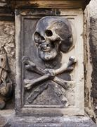 Stock Photo of skull and crossbones on headstone