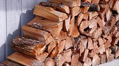 stacked fire wood - stock photo
