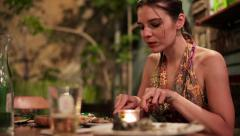 Beautiful womad eating dinner in outdoor restaurant HD Stock Footage