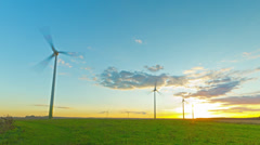 Windmills generators at sunset, time-lapse Stock Footage