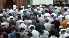Imam leads Friday prayer in mosque in Bishkek Kyrgyzstan Islam religion Stock Footage