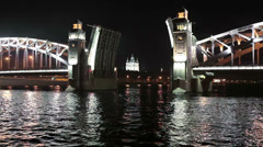 The Bolsheokhtinsky bascule bridge review from water at night, Saint-Petersburg Stock Footage