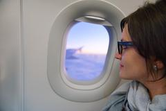 woman in airplane travel - stock photo