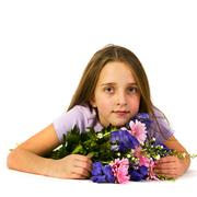Little girl with beautiful flowers Stock Photos
