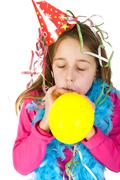 girl blowing balloon - stock photo