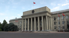 Parliament building in Bishkek with flags in top Stock Footage