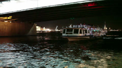 Tour boat passing throuth the span of Trinity bascule bridge. Saint-Petersburg Stock Footage