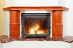 Fireplace in house interior Stock Photos