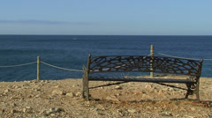 Bench in front of the blue sea Stock Footage