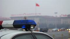 Police car parked on Chang'an Avenue,beside Tiananmen Square Stock Footage