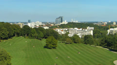 Germany Munich Olympia Park skyline meadow grassland Twin Towers Stock Footage