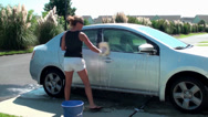 Stock Video Footage of Washing and rinsing the car