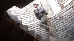 United States Army soldier walking up steps in Baghdad building Stock Footage