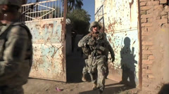 U.S. Soldiers of the Bravo Company leave residential compound in Baghdad Stock Footage