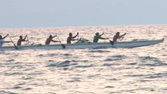 Dragon Boat Team Zoom Out to Beach Stock Footage