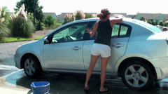 Woman washing a car Stock Footage