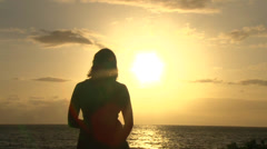 Woman Watching Sunset with Birds Flying By Stock Footage