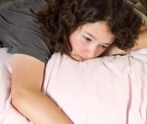 young girl tying to wake up in the morning - stock photo