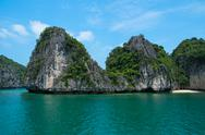Stock Photo of Mountain island and lonely beach in Halong Bay