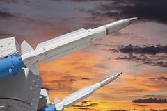 double missiles with sunset sky - stock photo