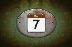 Old wooden calendar with may 7. Stock Illustration