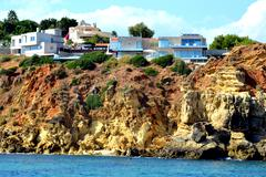 Cliffs baleeira, albufeira in the algarve Stock Photos