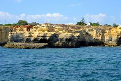 caves cliffs yellow albufeira in the algarve - stock photo
