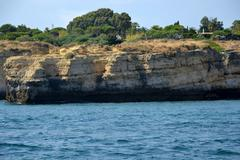 Caves cliffs yellow albufeira in the algarve Stock Photos