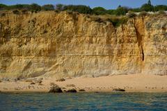 Caves cliffs yellow albufeira in the algarve Stock Photos