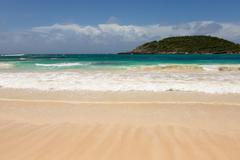 Atlantic waves on beautiful golden sandy beach antigua Stock Photos