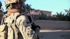 Medium close up United States Army Soldier Patrolling Streets of Baghdad Stock Footage
