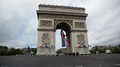 French Flag under Arch de Triumph during Victory Day celebration in Paris France Stock Footage