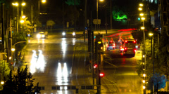 City streets traffic congestion night timelapse Athens zoom out - stock footage