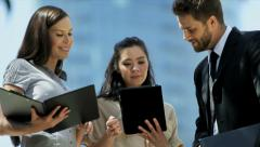 Multi ethnic business colleagues using wireless hot spot Stock Footage