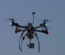 Multi-Rotor Drone flying over the Moore Plaza Towers Memorial Stock Footage