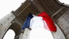 French Flag under Arch de Triumph during Victory Day celebration in Paris France - stock footage