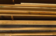 Various Boards Of Lumber Atacked In A Workshop - stock photo