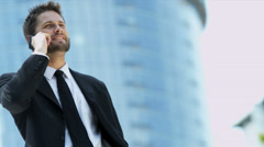 Businessman happy with success using smart phone Stock Footage