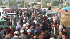 Local traders gather to buy and sell animals in Kyrgyzstan, crowd, Central Asia Stock Footage