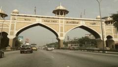 Vintage Stylized Driving Through Gates in Kuala Lumpur Malaysia Stock Video Stock Footage