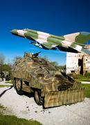 Military vehicle and mig 21 airplane Stock Photos