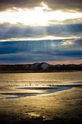 Sun beams through clouds in town of nin Stock Photos